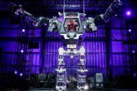 Amazon CEO Jeff Bezos Pilots Giant Robot Suit at 2017 MARS Conference